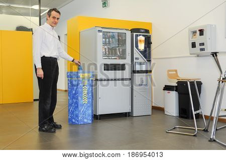Man Who Is Recycling A Bottle Of Pet