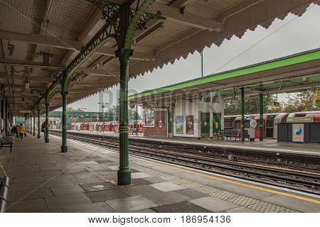 Hainault Ilford Essex UK - November 1 2017: Platform view of an outdoor underground station at Hainault Essex.