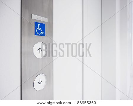 Disability signage lift Button Facility Priority Public accessibility Universal design