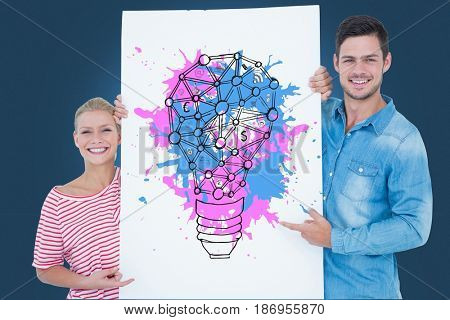 Digital composite of Portrait of couple holding billboard with colorful light bulb icon against blue background
