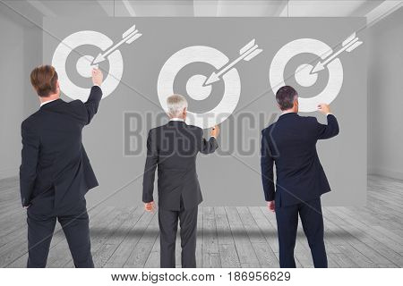 Digital composite of Digital composite image of business people drawing arrow with target symbol