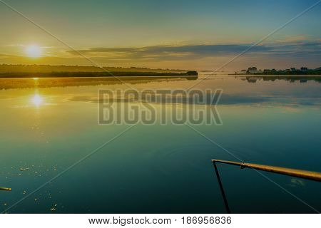 Dawn over the lake, the morning mist, the dawn sun. Beautiful bright dawn.