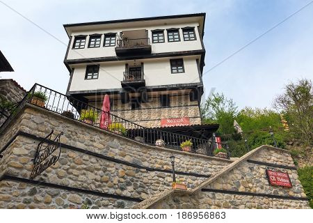 Melnik, Bulgaria - May 11, 2017: Street view with traditional bulgarian house with terrace from the Revival period in Melnik town, Bulgaria