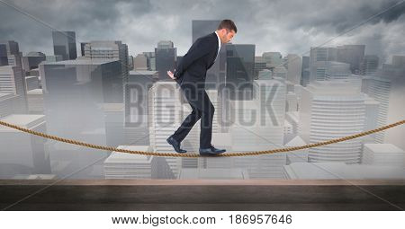 Digital composite of Digital composite image of businessman walking on rope against cityscape