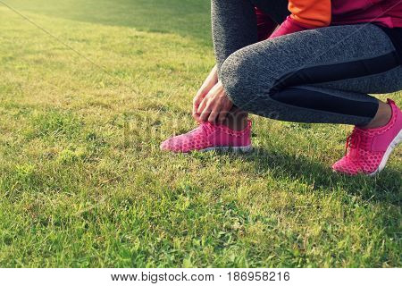 Runner athlete preparing to run the outdoor. Fitness woman training and jogging in summer park .