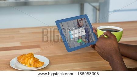 Digital composite of Cropped image of person holding digital tablet with join up page on screen while having coffee