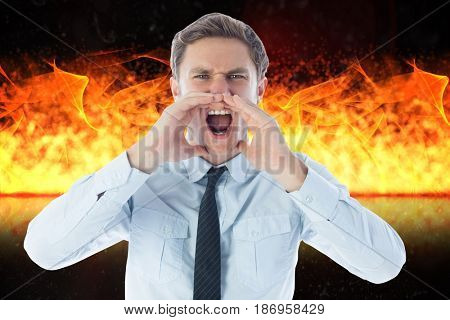 Digital composite of Digital composite image of angry businessman screaming against fire