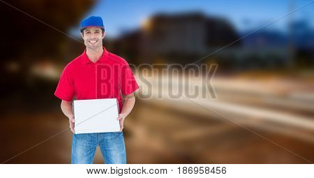 Digital composite of Delivery man holding pizza box