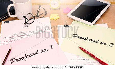 proofreading paper on table with office supplies