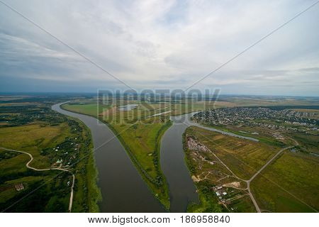 Aerial view on the river. Coudly summer day