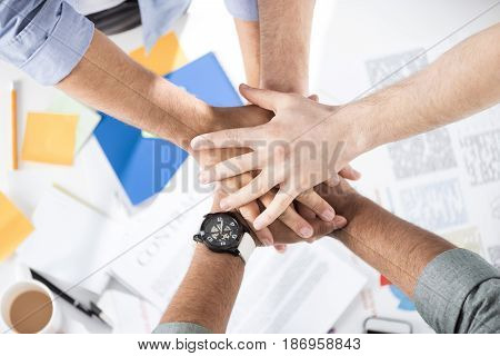 Close-up Partial View Of Businessmen Stacking Hands While Working On Project Together, Business Team