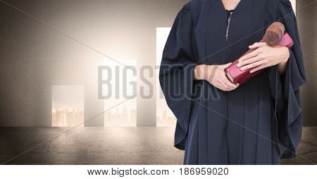 Digital composite of Midsection of judge with book and gavel