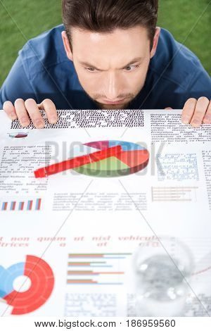 young businessman looking at documents with business charts and diagrams business establishment