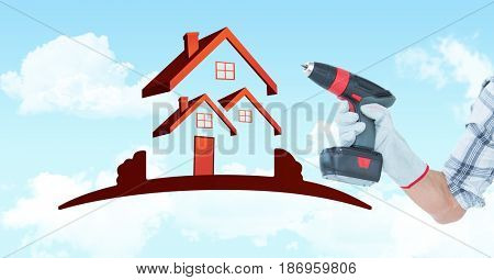 Digital composite of Hand holding drill machine by house shape in sky