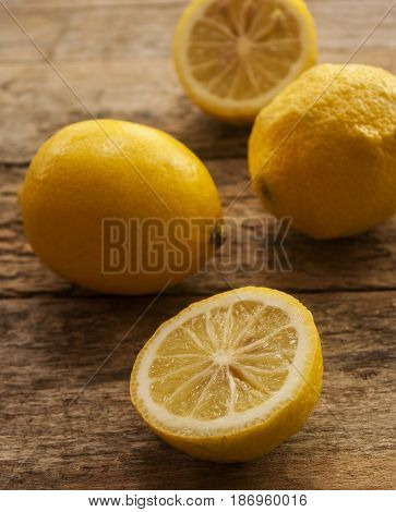 Lemon on old wooden background. Shallow depth of field, toned photo.