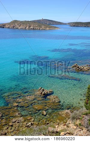 View on the beach with crystal sea water in Teulada in Sardinia Italy.