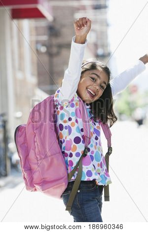 Cheering girl carrying backpack