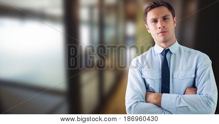 Digital composite of Portrait of businessman standing arms crossed