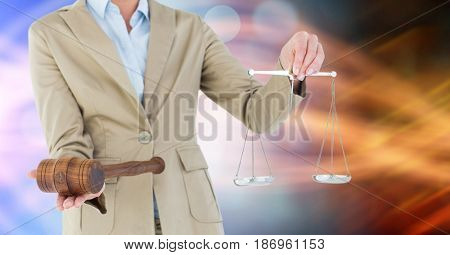 Digital composite of Midsection of judge holding gavel and law scales