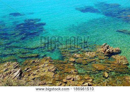 Crystal sea water and sea floor in Sardinia Italy.