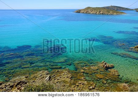 View on the beach Tuerredda with crystal sea water and Spanish Tower in Teulada in Sardinia Italy.