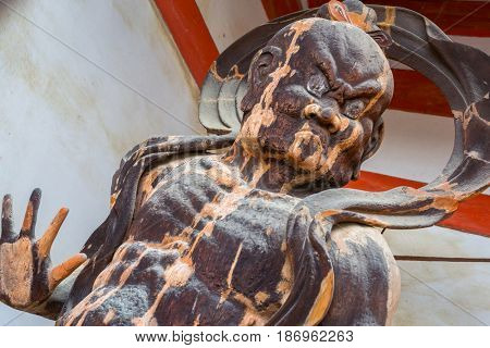 Statue of the guardian god at the gate in Kyoto, Japan