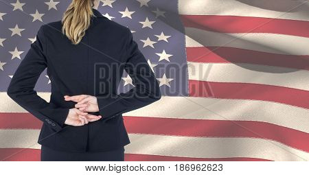 Digital composite of Midsection of female professional crossing fingers against American flag