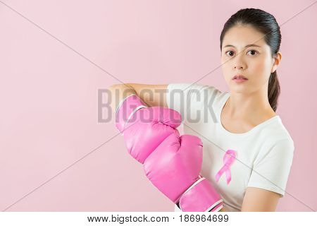 Woman Punch Boxing Gloves Together
