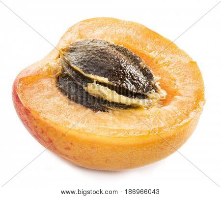 Ripe apricot's cross section with apricot seed in it. Clipping paths.
