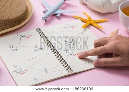 Hand choosing the route for your summer vacation