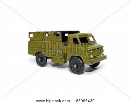 Military cargo vehicle on white background. Old soviet childrens toy.