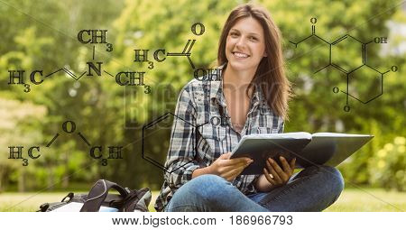 Digital composite of Female student holding book with formulas in foreground