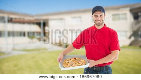Digital composite of Portrait of smiling delivery man holding pizza boxes against buildings