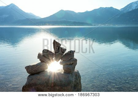 sun beam on a stone door at a lake