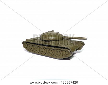 Tank - military vehicle on white background. Old soviet childrens toy.