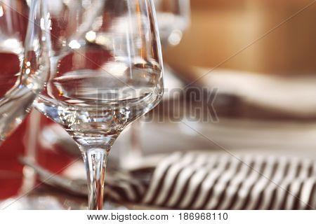 Wineglass on blurred background, closeup