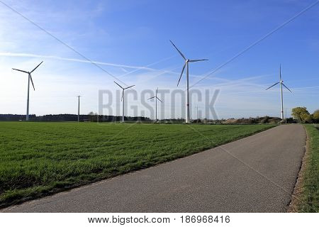 wind park with some wind wheels and urban landscape