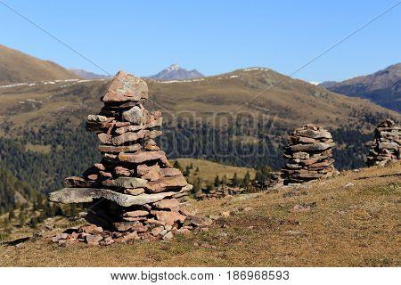 some stonemen on a peak of a mountain