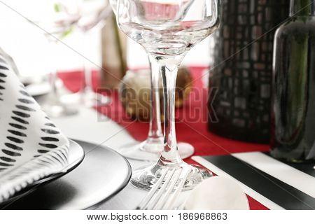 Empty wineglass on table