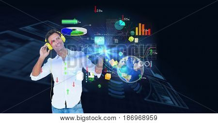 Digital composite of Smiling man using headphones while looking at virtual screen