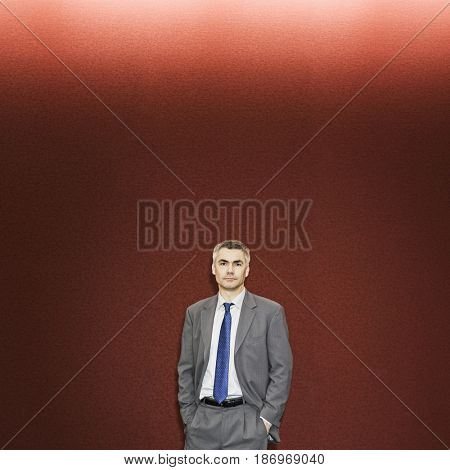 Caucasian businessman standing with hands in pockets