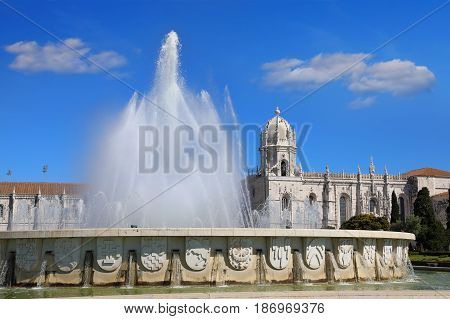 Fountain in Garden Praca do Imperio and Jeronimos Monastery in Lisbon. Portugal Belem district.