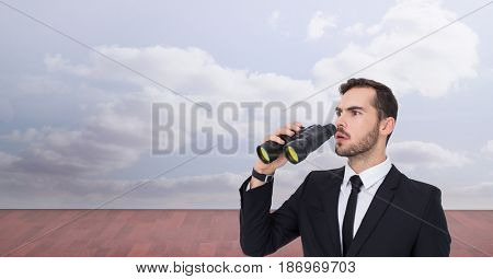 Digital composite of Shocked businessman looking away while holding binoculars