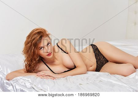 Portrait Of Young Elegant Red Haired Woman In Bed
