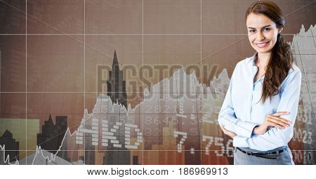 Digital composite of Businesswoman with arms crossed standing against graphs