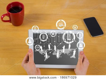 Digital composite of Hands with tablet and white network graphic