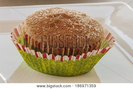 Christmas chocolate muffin glaze with coffe close up