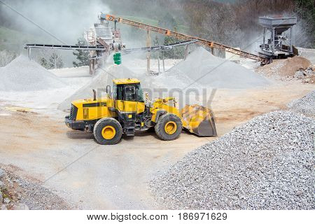 Quarry aggregate with heavy duty machinery picture