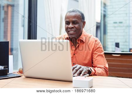 Handsome young Afro American businessman closeup picture