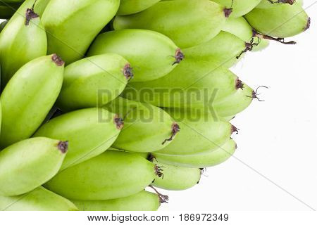 organic green  raw egg bananas  on white background healthy Pisang Mas Banana fruit food isolated